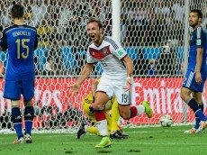 RIO DE JANEIRO, BRAZIL - JULY 13:  Mario Goetze of Germany celebrates scoring his team's first goal during the 2014 FIFA World Cup Brazil Final match between Germany and Argentina at Maracana on July 13, 2014 in Rio de Janeiro, Brazil.  (Photo by Matthias Hangst/Getty Images)