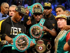 LAS VEGAS, NV - SEPTEMBER 13:  Floyd Mayweather Jr. celebrates his unanimous-decision victory over Marcos Maidana during their WBC/WBA welterweight title fight at the MGM Grand Garden Arena on September 13, 2014 in Las Vegas, Nevada.  (Photo by Al Bello/Getty Images)