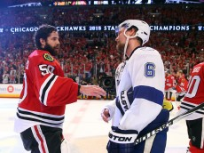 CHICAGO, IL - JUNE 15:  Corey Crawford #50 of the Chicago Blackhawks shakes hands with Anton Stralman #6 of the Tampa Bay Lightning after the Blackhawks won Game Six by a score of 2-0 to win the 2015 NHL Stanley Cup Final at the United Center  on June 15, 2015 in Chicago, Illinois.  (Photo by Bruce Bennett/Getty Images)