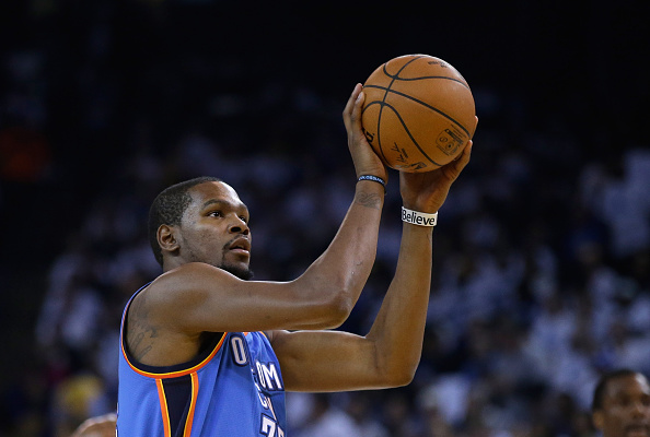 OAKLAND, CA - JANUARY 05:  Kevin Durant #35 of the Oklahoma City Thunder shoots a free throw against the Golden State Warriors at ORACLE Arena on January 5, 2015 in Oakland, California.  NOTE TO USER: User expressly acknowledges and agrees that, by downloading and or using this photograph, User is consenting to the terms and conditions of the Getty Images License Agreement.  (Photo by Ezra Shaw/Getty Images)