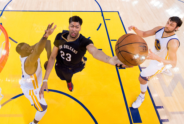OAKLAND, CA - APRIL 20: Anthony Davis #23 of the New Orleans Pelicans goes in for a layup over Draymond Green #23 and Andrew Bogut #12 of the Golden State Warriors in the third second half during the first round of the 2015 NBA Playoffs at ORACLE Arena on April 20, 2015 in Oakland, California. NOTE TO USER: User expressly acknowledges and agrees that, by downloading and or using this photograph, User is consenting to the terms and conditions of the Getty Images License Agreement.  (Photo by Pool-Getty Images)