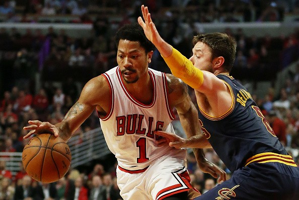 CHICAGO, IL - MAY 14:  Derrick Rose #1 of the Chicago Bulls drives against Matthew Dellavedova #8 of the Cleveland Cavaliers in the third quarter during Game Six of the Eastern Conference Semifinals of the 2015 NBA Playoffs at United Center on May 14, 2015 in Chicago, Illinois. NOTE TO USER: User expressly acknowledges and agrees that, by downloading and or using this photograph, User is consenting to the terms and conditions of the Getty Images License Agreement.  (Photo by Jonathan Daniel/Getty Images)