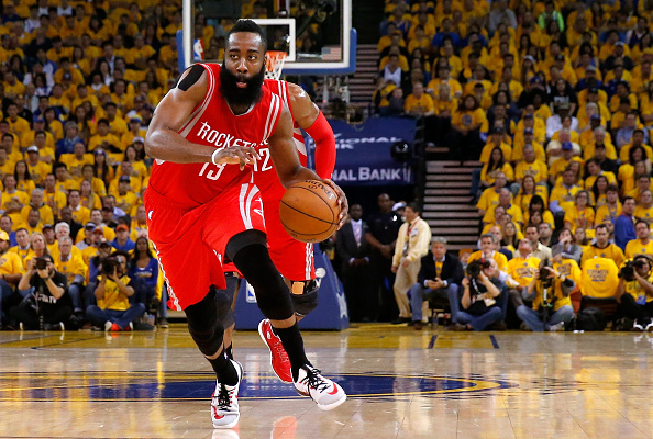 OAKLAND, CA - MAY 27:  James Harden #13 of the Houston Rockets drives to the basket in the first half against the Golden State Warriors during game five of the Western Conference Finals of the 2015 NBA Playoffs at ORACLE Arena on May 27, 2015 in Oakland, California. NOTE TO USER: User expressly acknowledges and agrees that, by downloading and or using this photograph, user is consenting to the terms and conditions of Getty Images License Agreement.  (Photo by Ezra Shaw/Getty Images)