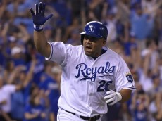 KANSAS CITY, MO - AUGUST 16:  Kendrys Morales #25 of the Kansas City Royals celebrates his game-winning RBI single in the 10th inning against the Los Angeles Angels of Anaheim at Kauffman Stadium on August 16, 2015 in Kansas City, Missouri. The Royals won 4-3. (Photo by Ed Zurga/Getty Images) *** Local Caption ***