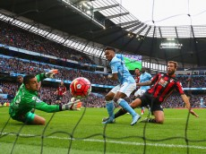 MANCHESTER, ENGLAND - OCTOBER 17:  Raheem Sterling of Manchester City scores his team's first goal past Adam Federici of Bournemouth during the Barclays Premier League match between Manchester City and A.F.C. Bournemouth at Etihad Stadium on October 17, 2015 in Manchester, England.  (Photo by Alex Livesey/Getty Images)