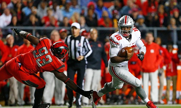 PISCATAWAY, NJ - OCTOBER 24: Quarterback J.T. Barrett #16 of the Ohio State Buckeyes avoids the pass rush of Djwany Mera #93 of the Rutgers Scarlet Knights during a game at High Point Solutions Stadium on October 24, 2015 in Piscataway, New Jersey. (Photo by Rich Schultz /Getty Images)
