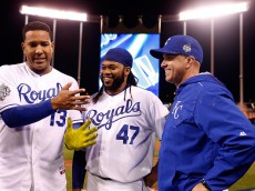 KANSAS CITY, MO - OCTOBER 28:  (L-R) Salvador Perez #13 of the Kansas City Royals, Johnny Cueto #47 of the Kansas City Royals, and Pedro Grifol #28 of the Kansas City Royals react after the Kansas City Royals defeat the New York Mets 7-1 in Game Two of the 2015 World Series at Kauffman Stadium on October 28, 2015 in Kansas City, Missouri.  (Photo by Christian Petersen/Getty Images)