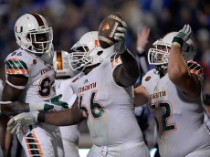 DURHAM, NC - OCTOBER 31:  Sunny Odogwu #66 of the Miami Hurricanes celebrates with teammates after recovering a fumble in the end zone for a touchdown during their game against the Duke Blue Devils at Wallace Wade Stadium on October 31, 2015 in Durham, North Carolina.  (Photo by Grant Halverson/Getty Images)
