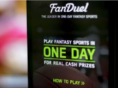 The FanDuel Inc. app is arranged for a photograph on an Apple Inc. iPhone in Washington, D.C., U.S., on Sunday, Oct. 4, 2015. Fantasy sports companies DraftKings Inc. and FanDuel Inc. raised a total of $575 million in July from investors including KKR & Co., 21st Century Fox Inc. and Major League Baseball to attract players to games that pay out millions of dollars in cash prizes in daily contests. Photographer: Andrew Harrer/Bloomberg via Getty Images