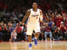 LOS ANGELES, CA - APRIL 28:  Glen Davis #0 of the Los Angeles Clippers celebrates after making a basket against the San Antonio Spurs during Game Five of the Western Conference quarterfinals of the 2015 NBA Playoffs at Staples Center on April 28, 2015 in Los Angeles, California.  The Spurs won 111-107.  NOTE TO USER: User expressly acknowledges and agrees that, by downloading and or using this photograph, User is consenting to the terms and conditions of the Getty Images License Agreement.  (Photo by Stephen Dunn/Getty Images)