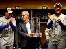 NEW YORK, NY - NOVEMBER 01:  Salvador Perez (R) #13 of the Kansas City Royals reacts in the clubhouse as manager Ned Yost (L) #3 of the Kansas City Royals and Kansas City Royals owner David D. Glass look on after the Kansas City Royals defeat the New York Mets to win Game Five of the 2015 World Series at Citi Field on November 1, 2015 in the Flushing neighborhood of the Queens borough of New York City. The Kansas City Royals defeated the New York Mets with a score of 7 to 2 to win the World Series.  (Photo by Al Bello/Getty Images)