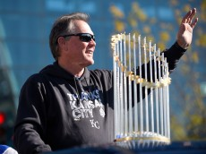 KANSAS CITY, MO -NOVERMBER 3:  Ned Yost manager of the Kansas City Royals waves to fans as he rides with the championship trophy during a parade to celebrate their World Series victory on November 3, 2015 in Kansas City, Missouri. (Photo by Ed Zurga/Getty Images)