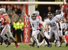 COLUMBUS, OH - NOVEMBER 21:  Michael Geiger #4 of the Michigan State Spartans celebrates after kicking a 41-yard field goal as time expired against the Ohio State Buckeyes at Ohio Stadium on November 21, 2015 in Columbus, Ohio. Michigan State defeated Ohio State 17-14.  (Photo by Jamie Sabau/Getty Images)