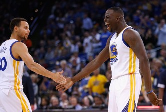 OAKLAND, CA - NOVEMBER 02:  Draymond Green #23 of the Golden State Warriors is congratulated by Stephen Curry #30 after he made a shot against the Memphis Grizzlies at ORACLE Arena on November 2, 2015 in Oakland, California. NOTE TO USER: User expressly acknowledges and agrees that, by downloading and or using this photograph, User is consenting to the terms and conditions of the Getty Images License Agreement.  (Photo by Ezra Shaw/Getty Images)