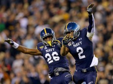 PHILADELPHIA, PA - DECEMBER 12:  Daiquan Thomasson #26 and Lorentez Barbour #2 of the Navy Midshipmen celebrate after Barbour intercepted a pass by Chris Carter of the Army Black Knights in the fourth quarter at Lincoln Financial Field on December 12, 2015 in Philadelphia, Pennsylvania.The Navy Midshipmen defeated the Army Black Knights 21-17.  (Photo by Elsa/Getty Images)