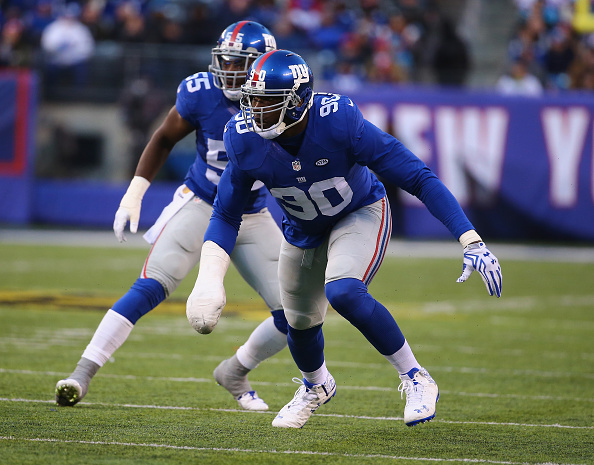EAST RUTHERFORD, NJ - DECEMBER 20:  Jason Pierre-Paul #90 of the New York Giants in action against  Mike Remmers #74 of the Carolina Panthers during their game at MetLife Stadium on December 20, 2015 in East Rutherford, New Jersey.  (Photo by Al Bello/Getty Images)