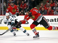 CHICAGO, IL - FEDRUARY 09: Trevor van Riemsdyk #57 of the Chicago Blackhawks passes under pressure from Joonas Donskoi #27 of the San Jose Sharks at the United Center on February 9, 2016 in Chicago, Illinois. (Photo by Jonathan Daniel/Getty Images)