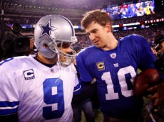 EAST RUTHERFORD, NJ - JANUARY 01:   Tony Romo #9 of the Dallas Cowboys and  Eli Manning #10 of the New York Giants greet each other after their game at MetLife Stadium on January 1, 2012 in East Rutherford, New Jersey.  (Photo by Jeff Zelevansky/Getty Images)