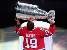 CHICAGO, IL - OCTOBER 7: Jonathan Toews #19 of the Chicago Blackhawks kisses the Stanley Cup during a pregame ceremony honoring the 2015 NHL Champions before the Blackhawks take on the New York Rangers during an NHL game at the United Center on October 7, 2015 in Chicago, Illinois. (Photo by Jonathan Daniel/Getty Images)