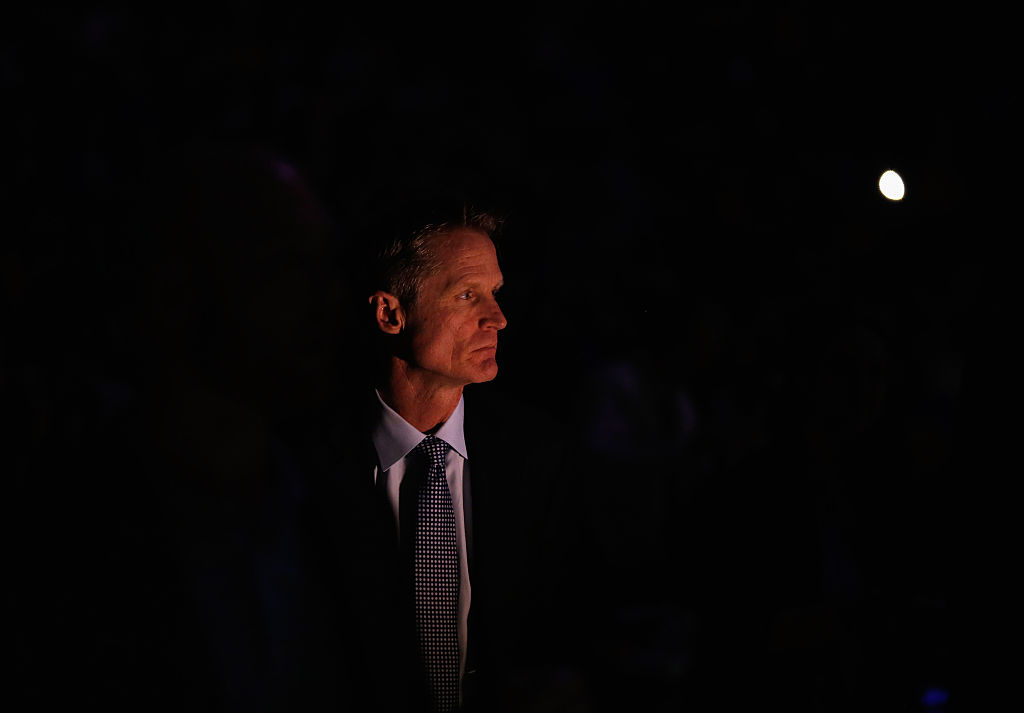 OAKLAND, CA - JANUARY 22:  Head coach Steve Kerr of the Golden State Warriors stands for player introductions before their game against the Indiana Pacers at ORACLE Arena on January 22, 2016 in Oakland, California.  This is Kerr's first game of the season. NOTE TO USER: User expressly acknowledges and agrees that, by downloading and or using this photograph, User is consenting to the terms and conditions of the Getty Images License Agreement.  (Photo by Ezra Shaw/Getty Images)