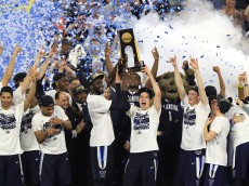 HOUSTON, TEXAS - APRIL 04:  Daniel Ochefu #23 of the Villanova Wildcats and Ryan Arcidiacono #15 hoist the trophy after the Villanova Wildcats defeat the North Carolina Tar Heels 77-74 to win the 2016 NCAA Men's Final Four National Championship game at NRG Stadium on April 4, 2016 in Houston, Texas.  (Photo by Scott Halleran/Getty Images)