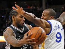 SAN ANTONIO,TX - APRIL 10: Kawhi Leonard #2 of the San Antonio Spurs drives on Andre Iguodala #9 of the Golden State Warriors at AT&T Center on April 10, 2016 in San Antonio, Texas. The Warriors won 92-86, tying the all-time record for wins in a season with 72. NOTE TO USER: User expressly acknowledges and agrees that , by downloading and or using this photograph, User is consenting to the terms and conditions of the Getty Images License Agreement. (Photo by Ronald Cortes/Getty Images)