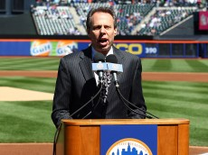 NEW YORK, NY - APRIL 05:  New York Mets announcer Howie Rose speaks at the podium during pregame festivities against the Atlanta Braves during their Opening Day Game at Citi Field on April 5, 2012 in New York City.  (Photo by Chris Chambers/Getty Images)