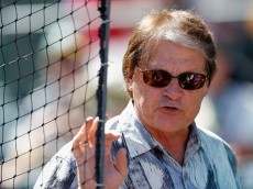 MESA, AZ - MARCH 10:  Chief baseball officer Tony La Russa of the Arizona Diamondbacks gestures as he talks with coaches in the dugout before the spring training game against the Oakland Athletics at HoHoKam Stadium on March 10, 2015 in Mesa, Arizona.  (Photo by Christian Petersen/Getty Images)