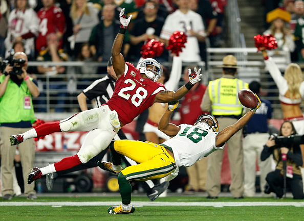 GLENDALE, AZ - JANUARY 16:  Wide receiver Randall Cobb #18 of the Green Bay Packers makes a catch against cornerback Justin Bethel #28 of the Arizona Cardinals but it was called back due to off setting penalties in the first half in the NFC Divisional Playoff Game at University of Phoenix Stadium on January 16, 2016 in Glendale, Arizona.  (Photo by Christian Petersen/Getty Images)
