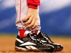 NEW YORK - OCTOBER 19:   Pitcher Curt Schilling #38 of the Boston Red Sox grabs at his ankle as it appears to be bleeding in the fourth inning during game six of the American League Championship Series against the New York Yankees on October 19, 2004 at Yankee Stadium in the Bronx borough of New York City. (Photo by Al Bello/Getty Images)