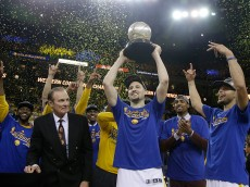 OAKLAND, CA - MAY 30:  Klay Thompson #11 of the Golden State Warriors hoists the Western Conference Championship Trophy after defeating the Oklahoma City Thunder in Game Seven of the Western Conference Finals during the 2016 NBA Playoffs at ORACLE Arena on May 30, 2016 in Oakland, California. NOTE TO USER: User expressly acknowledges and agrees that, by downloading and or using this photograph, User is consenting to the terms and conditions of the Getty Images License Agreement.  (Photo by Pool/Getty Images)