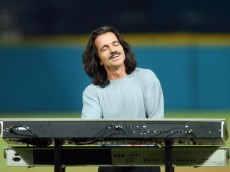 MIAMI - OCTOBER 23:  Recording artist Yanni performs the National Anthem prior to game five of the Major League Baseball World Series between the New York Yankees and the Florida Marlins on October 23, 2003 at Pro Player Stadium in Miami, Florida.  (Photo by Alan Diaz-Pool/Getty Images)