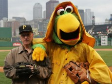 """PITTSBURGH - JUNE 03: In honor of his induction in the Hockey Hall of Fame, broadcaster Mike """"Doc"""" Emerick is greeted by the Pirate Parrot prior to the game between the Pittsburgh Pirates and the Houston Astros on June 3, 2008 at the PNC Park in Pittsburgh, Pennsylvania. (Photo by Bruce Bennett/Getty Images)"""