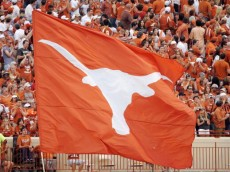AUSTIN, TX - SEPTEMBER 5:  A fan waves a large Lonhorns flag during the game between the Louisiana Monroe Warhawks and the Texas Longhorns on September 5, 2009 at Darrell K Royal-Texas Memorial Stadium in Austin, Texas. The Longhorns defeated the Warhawks 59-20. (Photo by Brian Bahr/Getty Images)