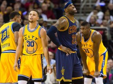 CLEVELAND, OH - JANUARY 18: Stephen Curry #30 of the Golden State Warriors and LeBron James #23 of the Cleveland Cavaliers react during the first half at Quicken Loans Arena on January 18, 2016 in Cleveland, Ohio. (Photo by Jason Miller/Getty Images)