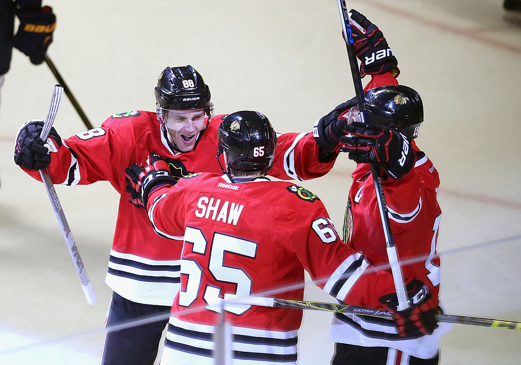 CHICAGO, IL - APRIL 23: (L-R) Patrick Kane #88, Andrew Shaw #65 and Jonathan Toews #19 of the Chicago Blackhawks celebrate Shaw's third period goal against the St. Louis Blues in Game Six of the Western Conference First Round during the 2016 NHL Stanley Cup Playoffs at the United Center on April 23, 2016 in Chicago, Illinois. The Blackhawks defeated the Blues 6-3. (Photo by Jonathan Daniel/Getty Images)
