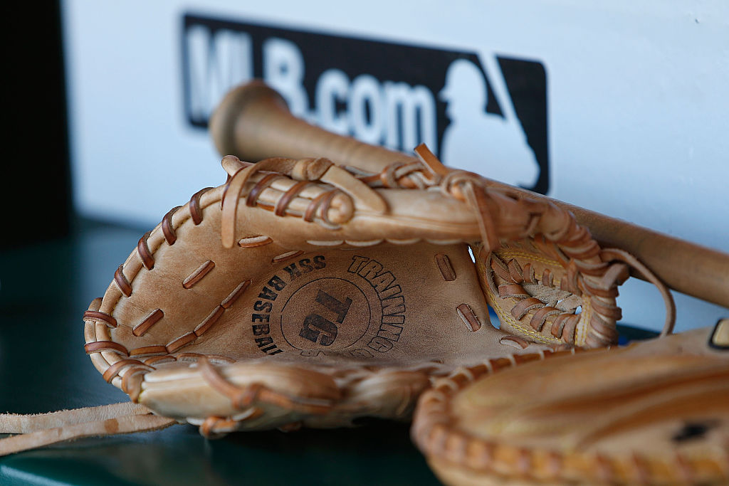 SAN FRANCISCO, CA - JULY 26: A bat and glove sit in the Oakland Athletics dugout before the game against the San Francisco Giants at AT&T Park on July 26, 2015 in San Francisco, California.  (Photo by Lachlan Cunningham/Getty Images)