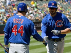 OAKLAND, CA - AUGUST 07: Kris Bryant #17 of the Chicago Cubs is congratulated by Anthony Rizzo #44 after Bryant hit a solo home run against the Oakland Athletics in the top of the six inning at Oakland Coliseum on August 7, 2016 in Oakland, California. (Photo by Thearon W. Henderson/Getty Images)