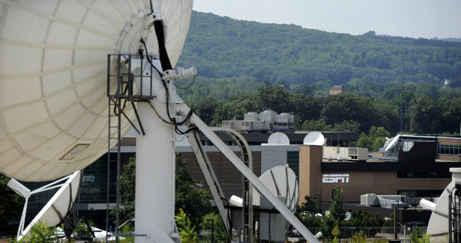 FILE - In this Aug. 2, 2011 file photo, satellite dishes dot the campus of ESPN in Bristol, Conn. Connecticut is using tax breaks and other financial incentives to attract similar companies, including NBC Sports and Back9Network to what is fast becoming an industry cluster. (AP Photo/Jessica Hill)