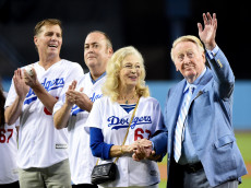 LOS ANGELES, CA - SEPTEMBER 23:  Los Angeles Dodgers broadcaster Vin Scully acknowledges applause from fans in front of wife Sandi Scully, and sons Kevin Scully and Todd Scully before the game against the Arizona Diamondbacks at Dodger Stadium on September 23, 2015 in Los Angeles, California.  (Photo by Harry How/Getty Images)