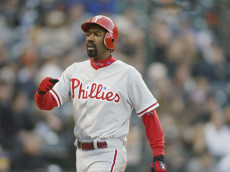 SAN FRANCISCO - APRIL 30:  Center fielder Doug Glanville #6 of the Philadelphia Phillies walks on the field during the MLB game against the San Francisco Giants at Pac Bell Park in San Francisco, California on April 30, 2002. The Phillies won 8-2. (Photo by Jed Jacobsohn/Getty Images)