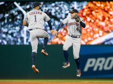 CLEVELAND, OH - SEPTEMBER 6: Carlos Correa #1 and George Springer #4 of the Houston Astros celebrate after the Astros defeated the Cleveland Indians at Progressive Field on September 6, 2016 in Cleveland, Ohio. The Astros defeated the Indians 4-3. (Photo by Jason Miller/Getty Images)