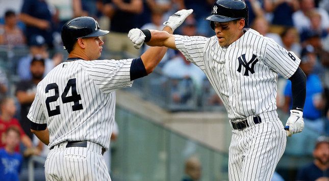 NEW YORK, NY - SEPTEMBER 10:  Jacoby Ellsbury #22 of the New York Yankees celebrates his sixth inning two run home run against the Tampa Bay Rays with teammate Gary Sanchez #24 at Yankee Stadium on September 10, 2016 in the Bronx borough of New York City.  (Photo by Jim McIsaac/Getty Images)