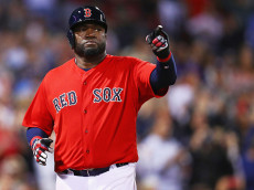 BOSTON, MA - SEPTEMBER 16:  David Ortiz #34 of the Boston Red Sox celebrates after scoring a run against the New York Yankees  during the sixth inning at Fenway Park on September 16, 2016 in Boston, Massachusetts.  (Photo by Maddie Meyer/Getty Images)