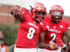 LOUISVILLE, KY - SEPTEMBER 17:  Lamar Jackson #8 of the Louisville Cardinals celebrates with Jamari Staples #2 after he ran for a touchdown against the Florida State Seminoles  at Papa John's Cardinal Stadium on September 17, 2016 in Louisville, Kentucky.  (Photo by Andy Lyons/Getty Images)