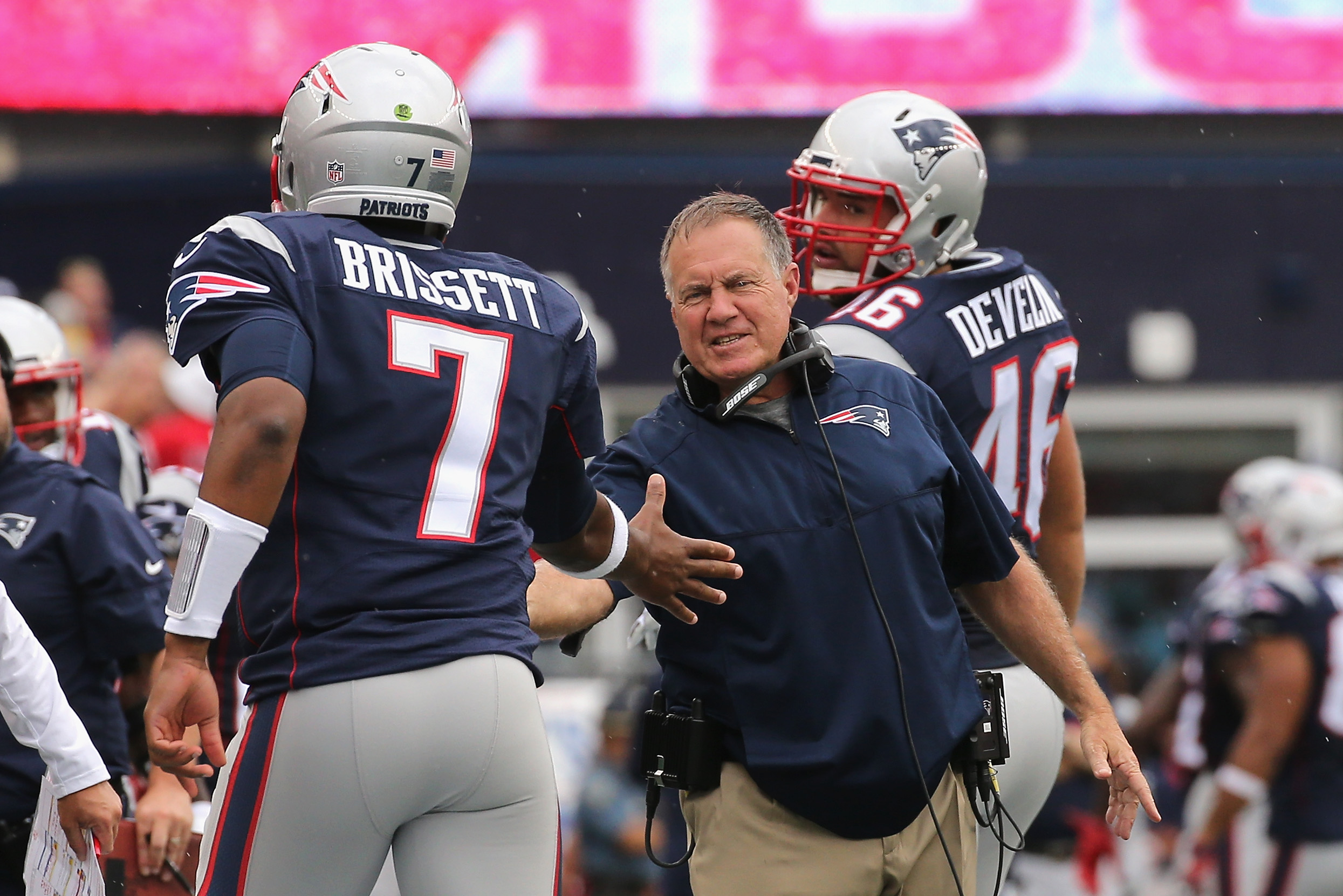FOXBORO, MA - SEPTEMBER 18:  Head coach Bill Belichick of the New England Patriots high fives Jacoby Brissett #7 during the second half against the Miami Dolphins at Gillette Stadium on September 18, 2016 in Foxboro, Massachusetts.  (Photo by Jim Rogash/Getty Images)