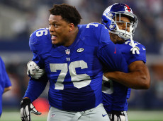 ARLINGTON, TX - SEPTEMBER 13:  Ereck Flowers #76 of the New York Giants is held by  Rashad Jennings #23 in the fourth quarter during play against the Dallas Cowboys at AT&T Stadium on September 13, 2015 in Arlington, Texas.  (Photo by Ronald Martinez/Getty Images)