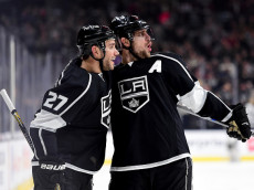 LOS ANGELES, CA - JANUARY 09:  Anze Kopitar #11 of the Los Angeles Kings celebrates his goal with Alec Martinez #27  to take a 1-0 lead over the St. Louis Blues during the second period at Staples Center on January 9, 2016 in Los Angeles, California.  (Photo by Harry How/Getty Images)