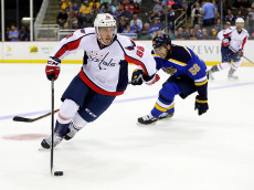 KANSAS CITY, MO - OCTOBER 05:  Nate Schmidt #88 of the Washington Capitals controls the puck during the preseason game against St. Louis Blues at Sprint Center on October 5, 2016 in Kansas City, Missouri.  (Photo by Jamie Squire/Getty Images)