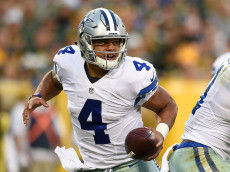 GREEN BAY, WI - OCTOBER 16: Dak Prescott #4 of the Dallas Cowboys looks to pass against the Green Bay Packers during the third quarter at Lambeau Field on October 16, 2016 in Green Bay, Wisconsin. The Dallas Cowboys defeated the Green Bay Packers 30-16.  (Photo by Hannah Foslien/Getty Images)